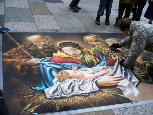 Koln, Germany-A street painter brings colosr to life